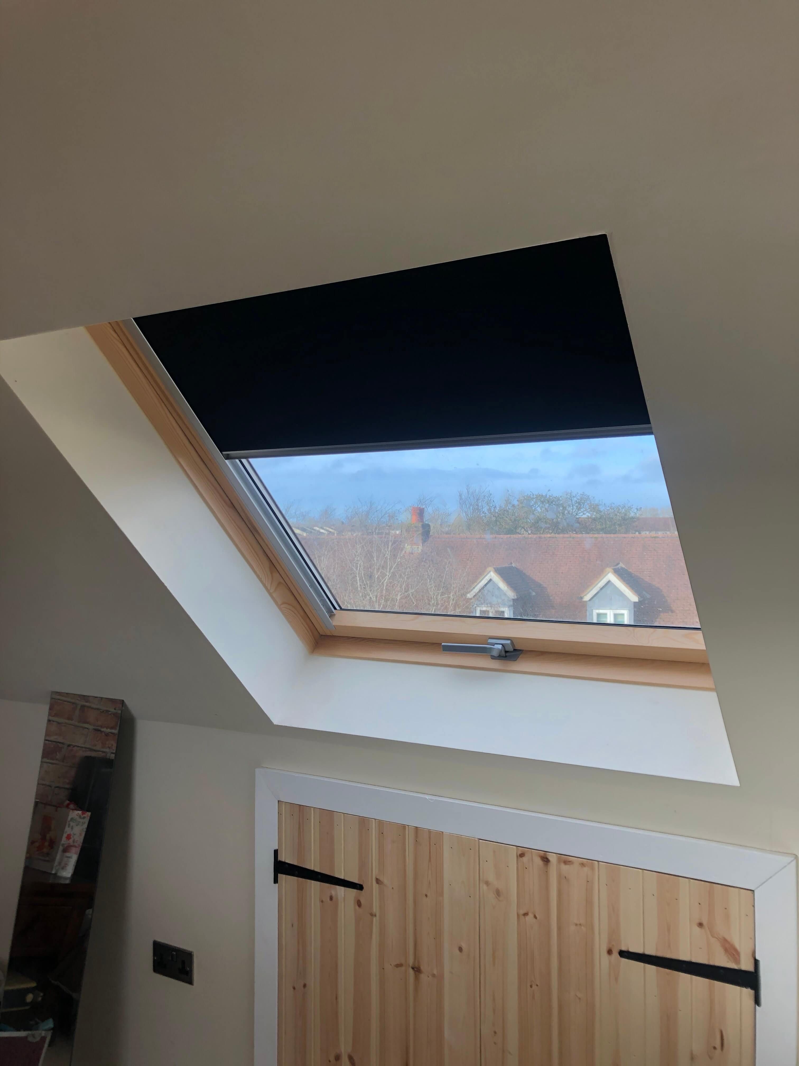 Dakea Ultima™ roof windows in the classic wooden finish