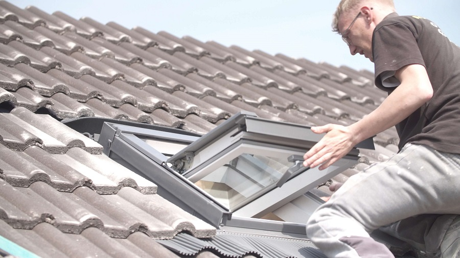 Checking a skylight window for the cause of a leak