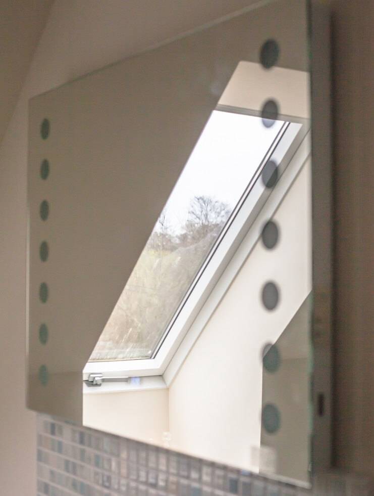 Mirror reflecting light from window